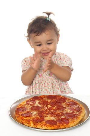 Baby girl clapping over a pepperoni pizza, with motion blur in hands