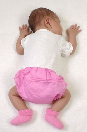 Newborn baby girl sleeping, 3 weeks old Stock Photo - 4256714