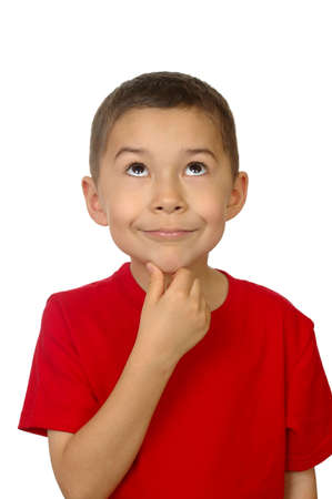 Seven-year-old boy looking up thinking photo