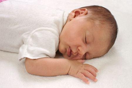 newborn three-week-old baby girl asleep photo