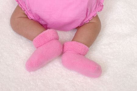 legs of newborn baby girl in pink bloomers, 3 weeks old Stock Photo - 4265112