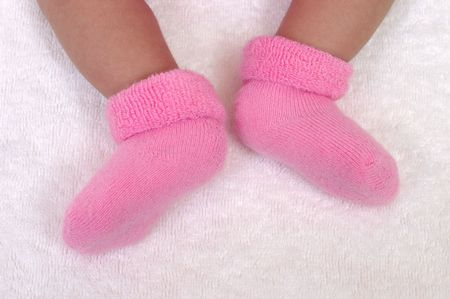 weeks: newborn baby girl feet, three weeks old