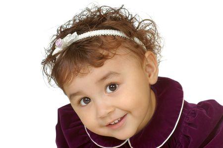 velvet dress: two-year-old girl in purple velvet dress, isolated on white