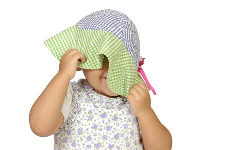 peekaboo: girl playing peekaboo behind hat, isolated on white Stock Photo