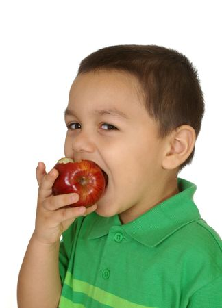 three year old kid eating an apple, isolated on white photo