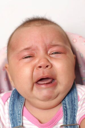 Four month old baby girl crying Stock Photo - 4816286