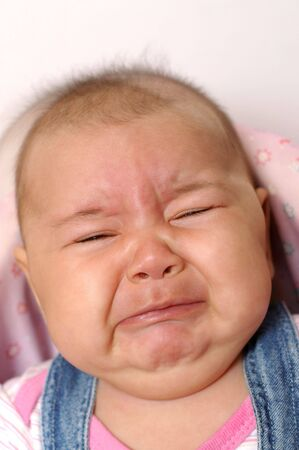Four month old baby crying Stock Photo - 5111920