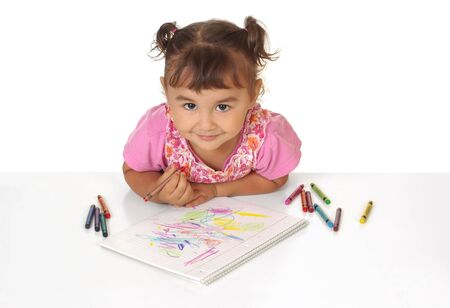 one year: two-year-old girl scribbling with crayons, over white background