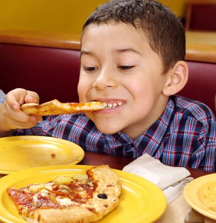 boy eating pizza photo