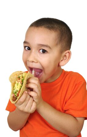 consume: Hispanic boy with Mexican taco, isolated on white Stock Photo