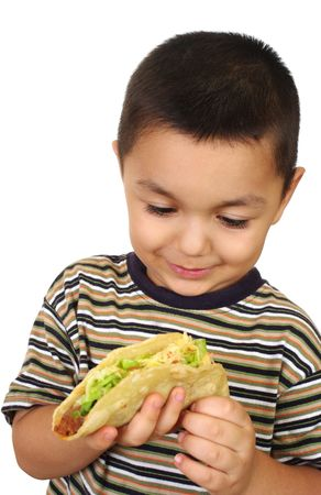 crewcut: Hispanic kid with taco, isolated on white Stock Photo