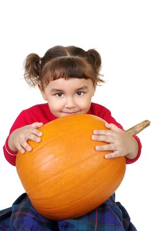 adorable little girl hugging a big fresh pumpkin, isolated on white photo