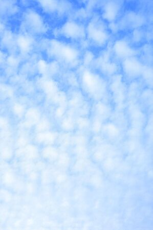 blue sky with white fuzzy clouds, perfect for a background photo