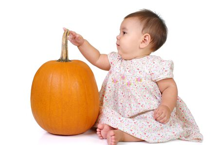 kid with a pumpkin, isolated on white photo