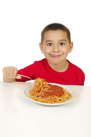 kid eating spaghetti Stock Photo