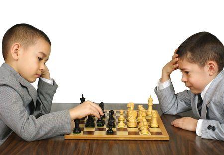 Kids playing chess photo