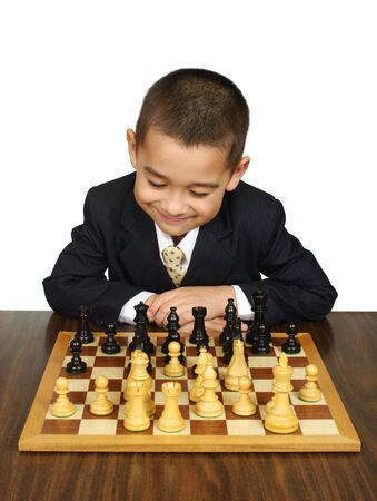 Kid playing chess, smiling, winning