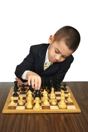 crewcut: Kid making a chess move