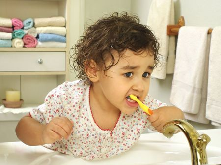 Kid brushing teeth Stock Photo - 6838223