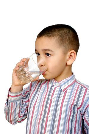 Boy drinking glass of water photo
