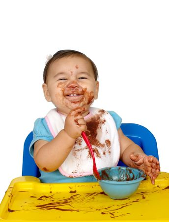 messy: baby with chocolate pudding messy face