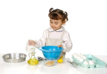 Little girl baking Banco de Imagens