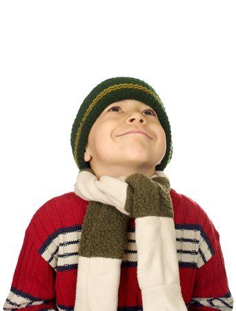 warm clothes: Capretto in abiti caldi guardando sorridente