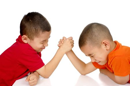 grapple: Kids arm-wrestling, six and eight years old Stock Photo