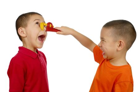 crewcut: Boy pinching anothers nose with toy wrench