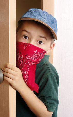 Boy sneaking through door photo