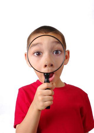 amaze: Boy looking through magnifying glass