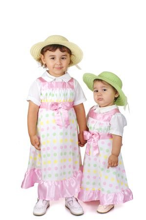 Cute little girls in pink dresses photo