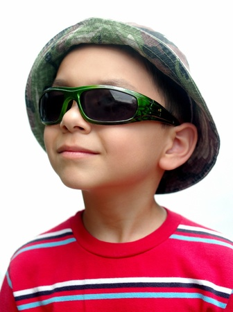 kid with green sunglasses and camo hat photo