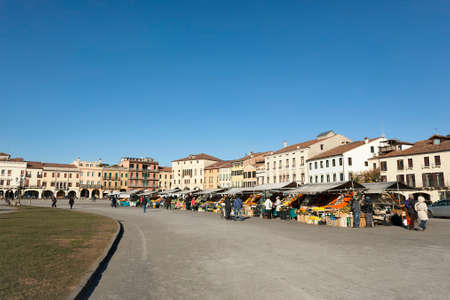 Italy, Padua January. 2017 Fruit market in the center of the city, an island in the shape of an ellipse,big square