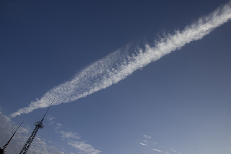 across: airplane traces across the sky