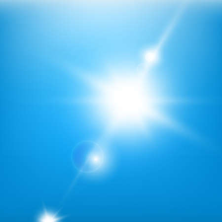 Sun beams on a blue sky background