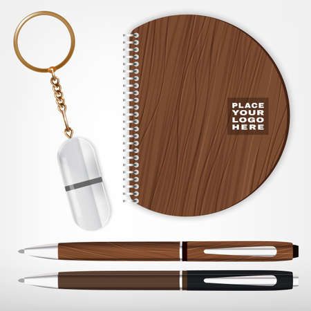 fob: Vector illustration of a wooden and metal souvenirs with a rings for a key, notebook and pens Isolated on a white background. Ideal template for branding, identity guidelines and promo campaigns.