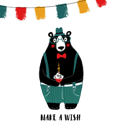 Birthday greeting card with phrase: make a wish. Dressed up cute black bear holding a cupcake with candle.