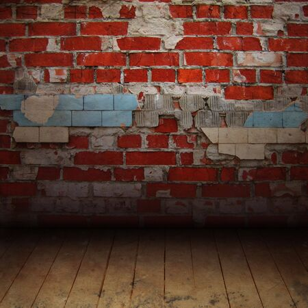 Texture of the old brick wall with a wooden floor Stock Photo