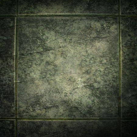 Old, green, cracked ceramic tile
