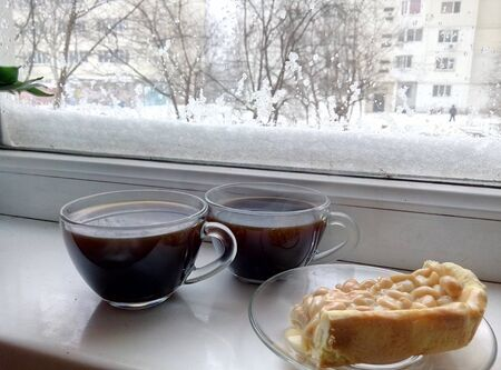 windowsill: hot coffee on a windowsill Stock Photo
