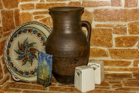 niche: Still Life from a jug, plates that are in the niche