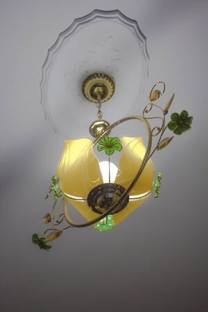 electrolier: bright yellow on a white ceiling chandelier