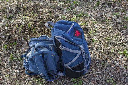 packsack: dark blue hiking backpacks lying on the ground