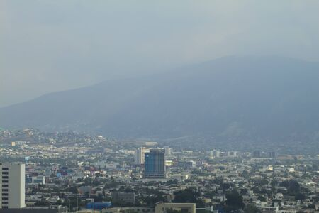 Mist in the middle of the city that rises one day in August in Mexico