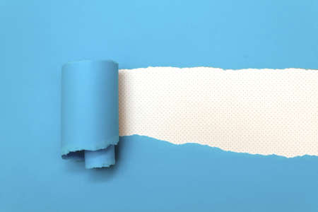 Ripped blue paper with space for text Stock Photo - 21648288