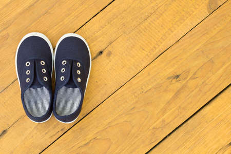 Blue shoes on wooden floor photo