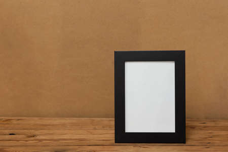 Frame. Frame on a wooden table. Place for your text photo