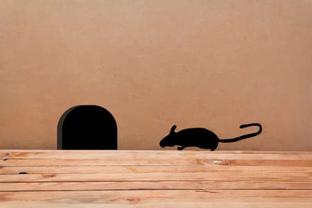 house mouse: Mouse House in the wall. Silhouette mouse. Little Mouse comes in a hole