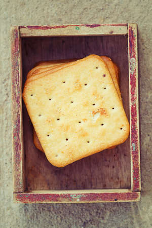 Square crackers in vintage box. photo